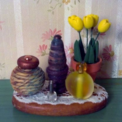 Picture of Second hand dollhouse yellow tulip floral arrangement.