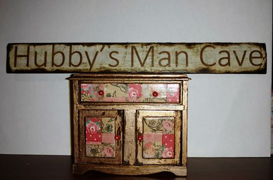 Picture of Dina's Man Cave sign on wood