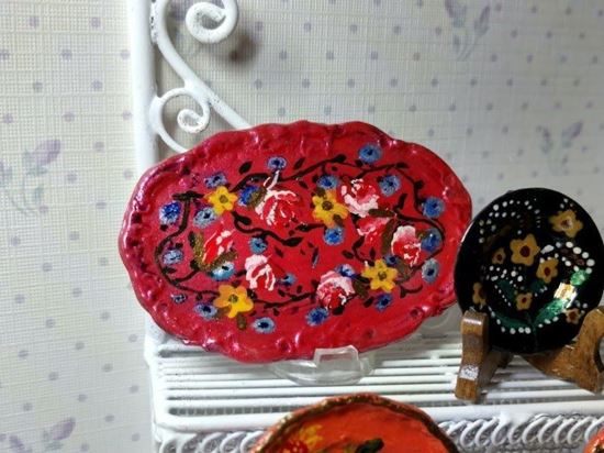 Picture of Hand painted platter or tray with flowers on pink background.