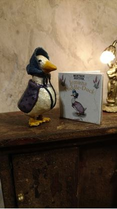Picture of Dollhouse Jemima Puddle Duck and readable book about her.