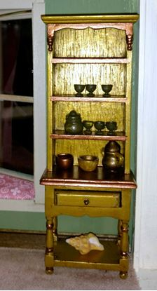 Picture of Dollhouse miniature hutch with accessories