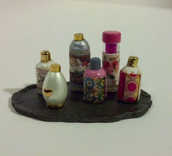 Picture of Miniature perfume and other vanity items on tray