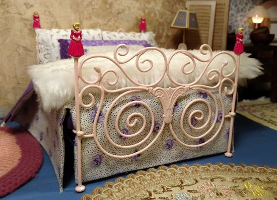 Picture of Handmade Metal Bed w/pink dolls for bed posts.