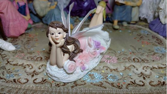 Picture of Miniature Fairy Lying on the Ground