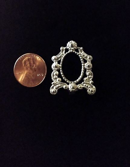 Picture of Miniature cast old ornate pewter standing frame.